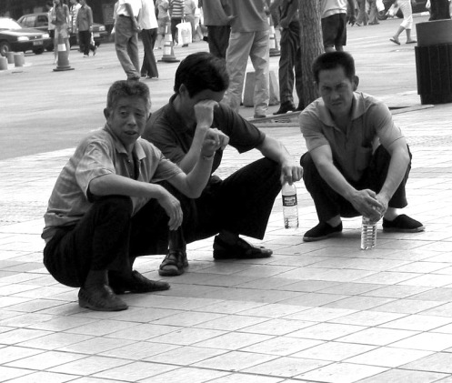 beijing-wangfujing-men-squatting-large